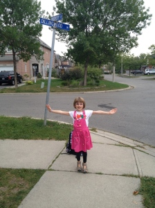 Abby posing at the bus stop