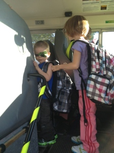 Aiden getting on the bus for the first time