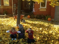 Kids making scary faces in front of decorated house