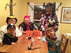 Everyone enjoying some time after trick or treating.