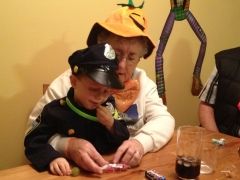 Mama helping Aiden dig into candy