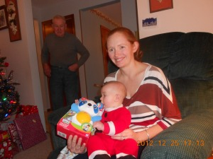 Julie with Macklan's new present while Uncle Joe looks on.