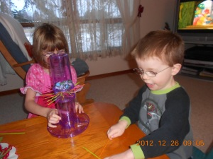 Abby & Aiden playing Kerplunk which they got for Christmas.