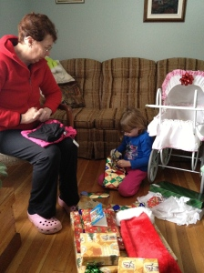 Abby with Grandma opening her presents.