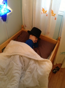 Aiden sleeping with his magician hat.