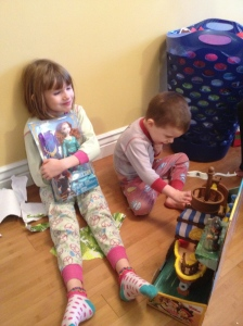 Abby and Aiden with some of their gifts.