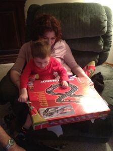 Melissa and Aiden inspecting his new racetrack.