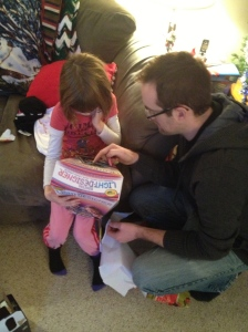 Uncle Rob showing Abby her new present.