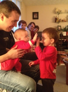Aiden giving his cousin Macklan a high five.