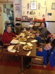 Aiden, Abby & Melissa eating at Sandra's restaurant.