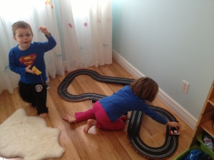 Aiden & Abby playing with Aiden's new racetrack.