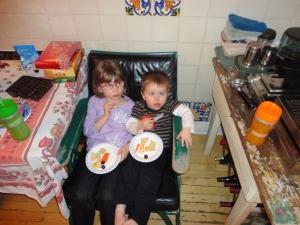 Kids eating their snacks on chair in Steven & Karen's Kitchen