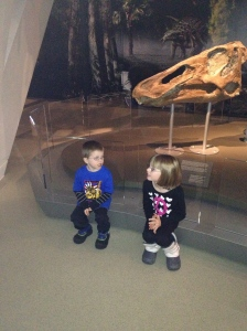 Abby & Aiden sitting and waiting to go to the next exhibit