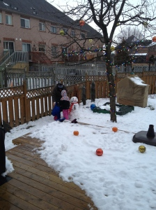Dad, Abby & Aiden making their first snowman