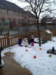 Dad, Abby & Aiden putting the finishing touches on their snowman