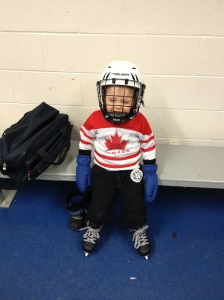 Aiden dressed and waiting to go out on the ice