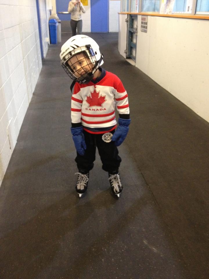 Aiden showing off his skates & helmet