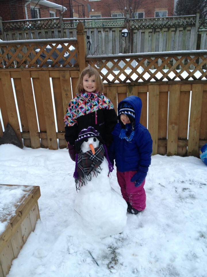 Abby & Aiden with their first round of decorating for the snowman