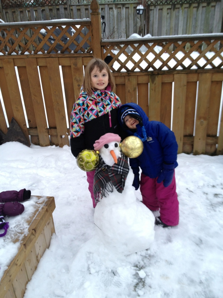 Abby & Aiden with the snowman that Abby made