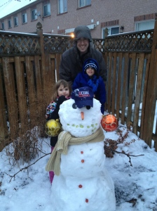 Abby, Aiden & Dad showing off their snowman (Check out those earrings)