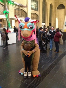 Abby hugging the dinosaur mascot