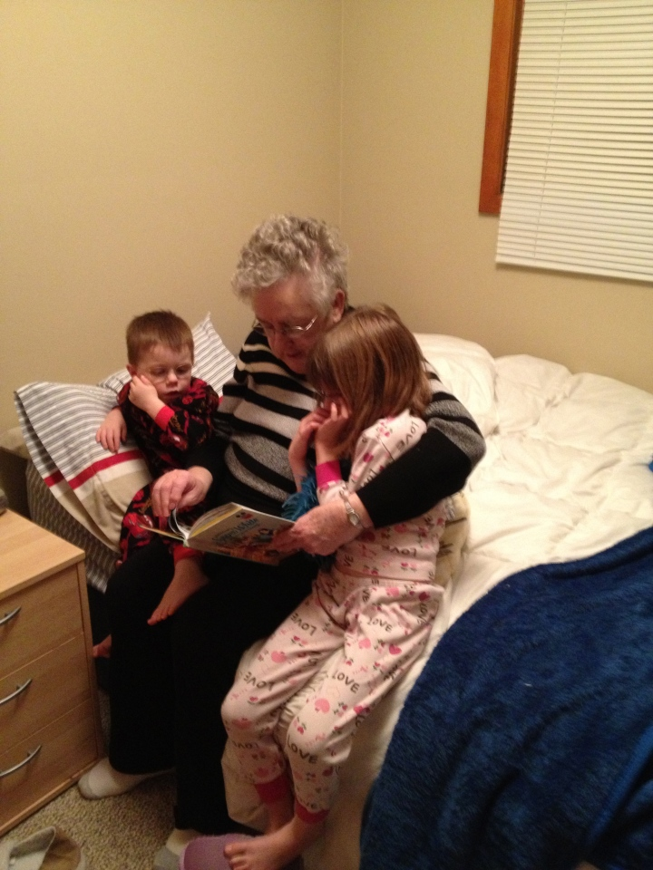 Mama reading Snow White and the Seven Dwarves to Abby & Aiden
