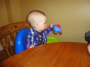 Macklan looking under his sippy cup for food