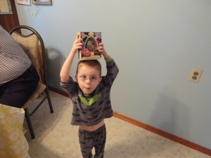 Aiden showing off his toy from the Easter bunny