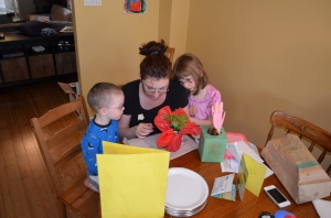 Mommy looking at Aiden's card and gift that he made at school.