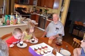 Abby & Aiden blowing out candles on the cupcakes