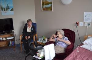 Linda with Grandma Rose in her new room.