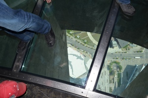 Aiden looking through the glass floor