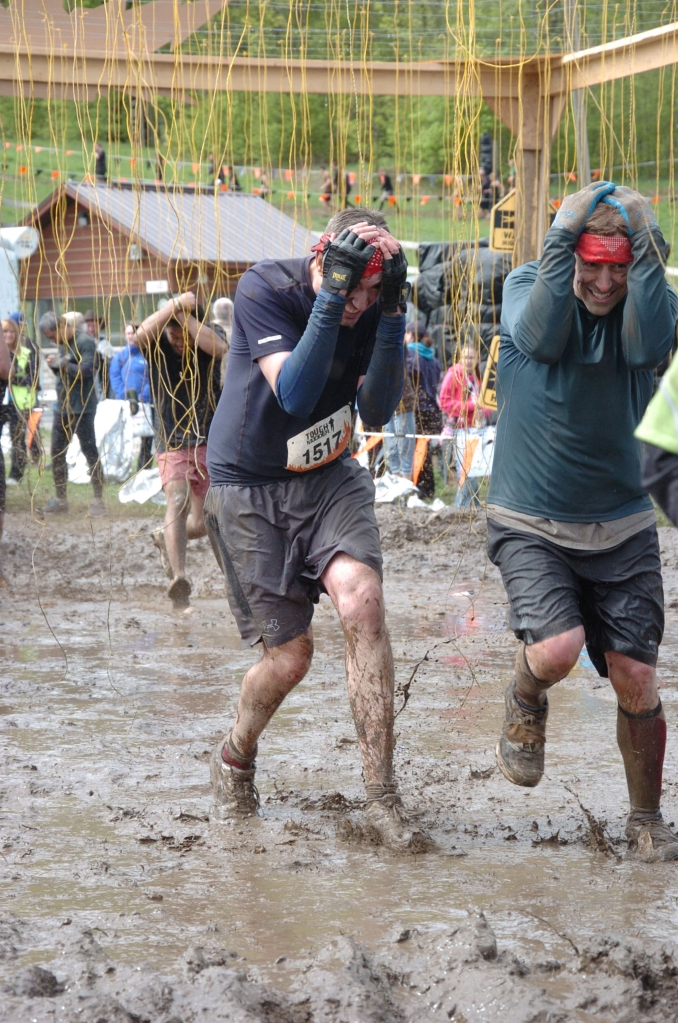 Peter & Brian running through last obstacle.