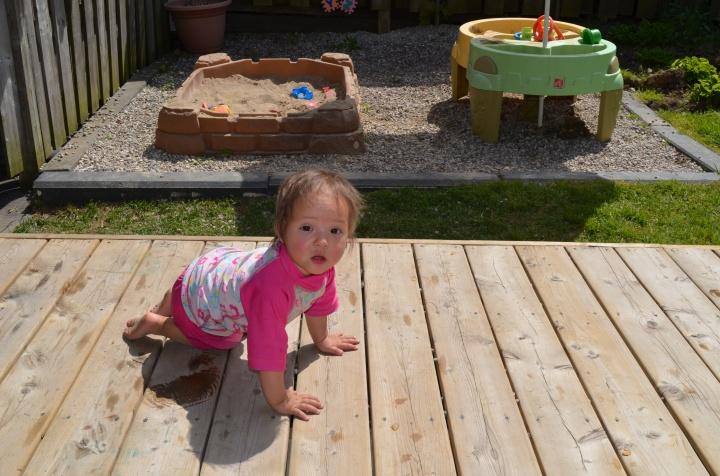 Chloe crawling on the deck
