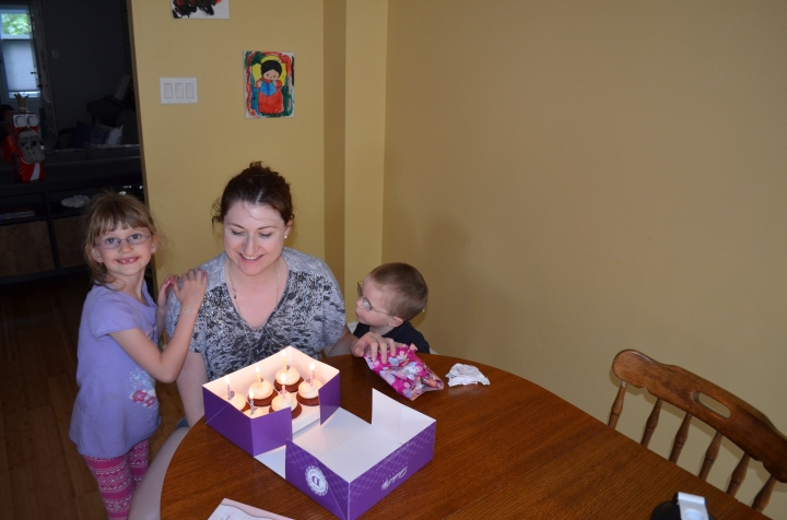 Melissa, Abby & Aiden about to blow out her cupcakes