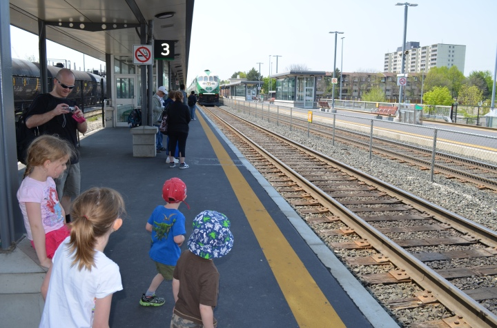 The kids looking to see Go Train coming