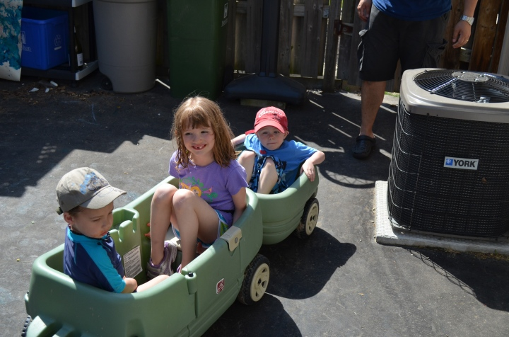 Owen, Abby & Aiden loaded up for ride to store