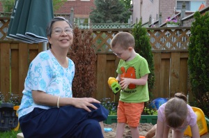 Sandra playing with Aiden & Abby in sandbox