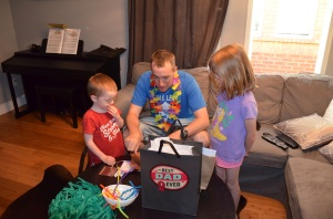 Peter with Abby & Aiden opening his presents