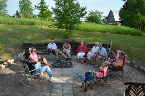 L-R: Steve, Barb, Bill, Carol, Aunt Dorothy, Aunt Linda, Bill Smith & John sitting around fire pit