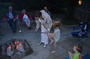 Jane helping Abby roast marshmallows