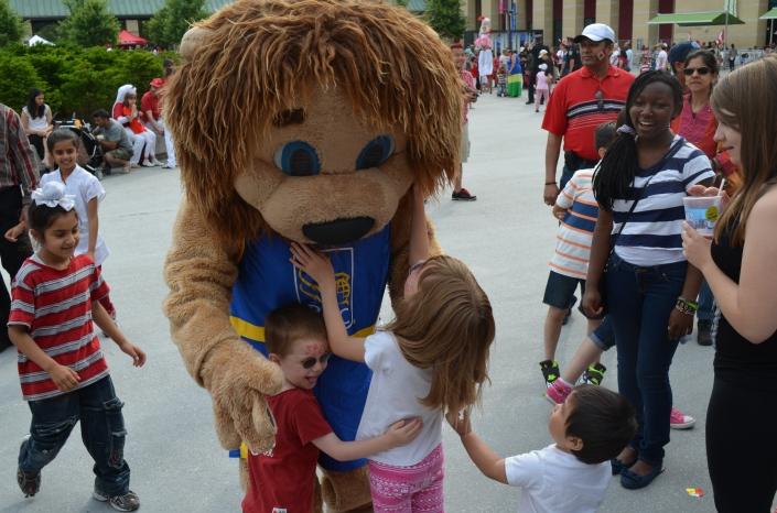 Aiden & Abby hugging the RBC mascot