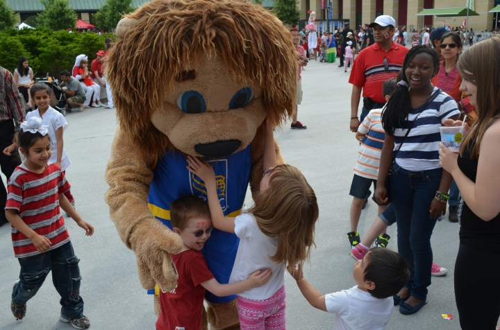 Aiden & Abby hugging the RBC mascot