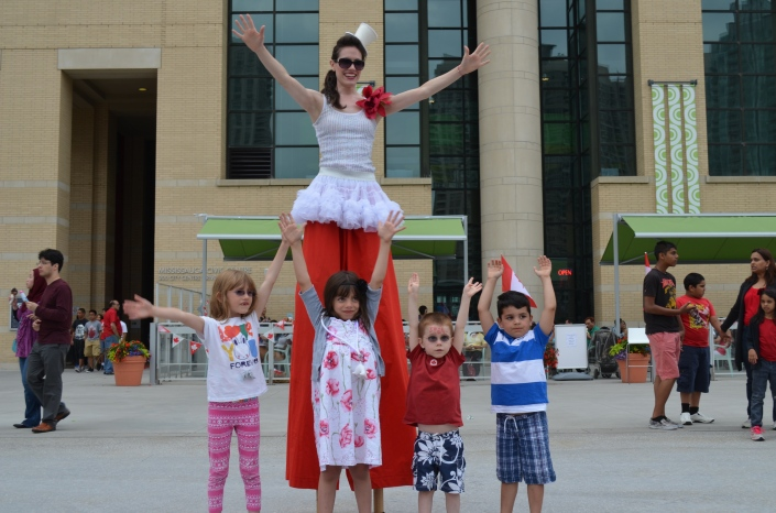 Abby, Serena, Aiden and AJ giving the hands up for the lady in stilts