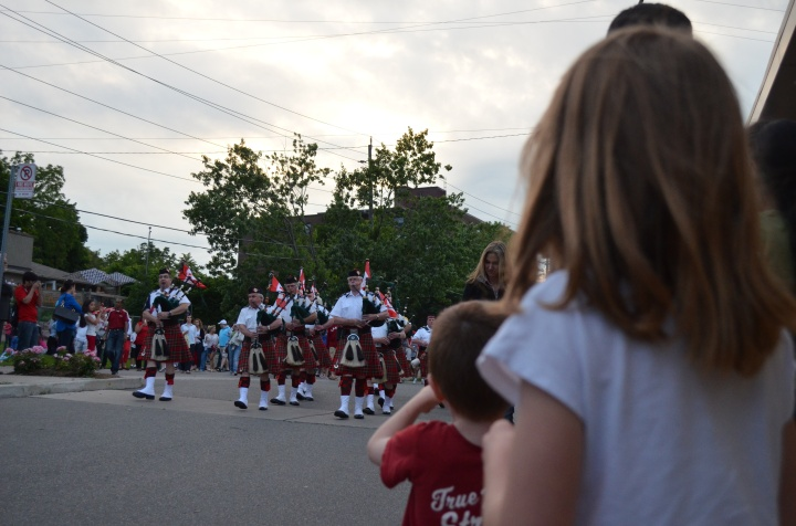Aiden & Abby watching the marching band go by.