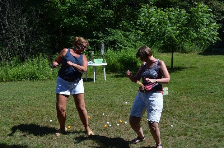 Sue and Carol playing ping pong game