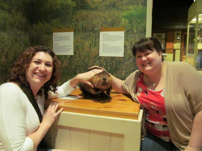 Melissa & Megan petting a beaver