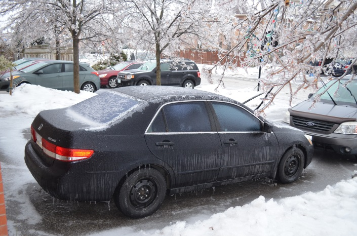 car covered in an inch of ice