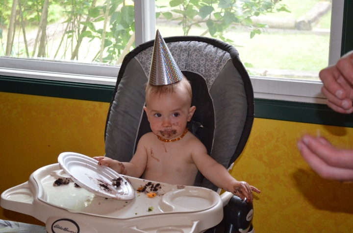 Enjoying his first chocolate cake