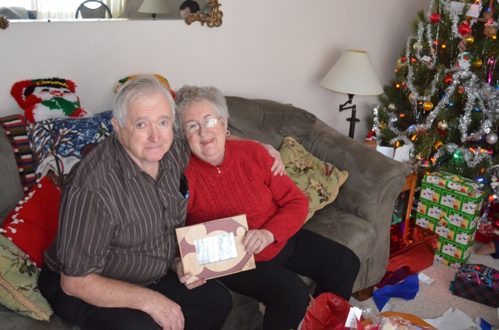 Mom & Dad with picture frame gift for Christmas